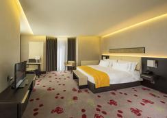 Berd's Design Hotel - คีชีเนา - ห้องนอน