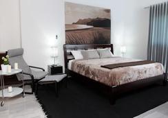 Hotel Casa Jum - ซานติอาโก เด โลส กาบาเยโรส - ห้องนอน