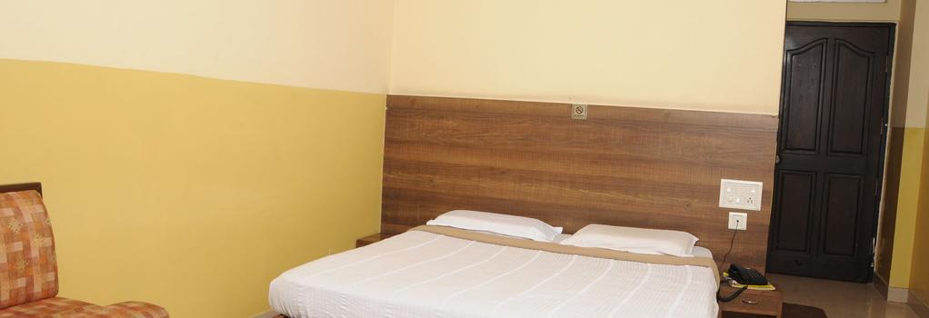 Suvarna Residency - Mysore - Bedroom