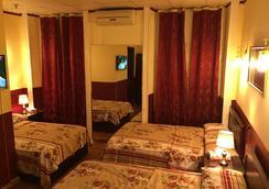 Cairo Inn - ไคโร - ห้องนอน