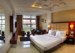 Rajmahal Inn - มัยซอร์ - ห้องนอน