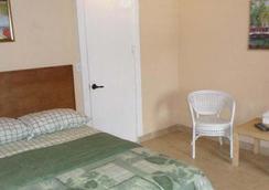 Richmond Inn - คริสเตียน - ห้องนอน