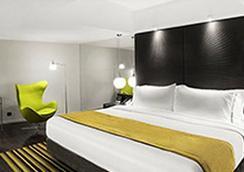 Uny Hotel - ยอร์กยาการ์ตา - ห้องนอน