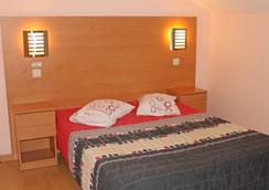 Guest House Estrela - ปอร์โต - ห้องนอน