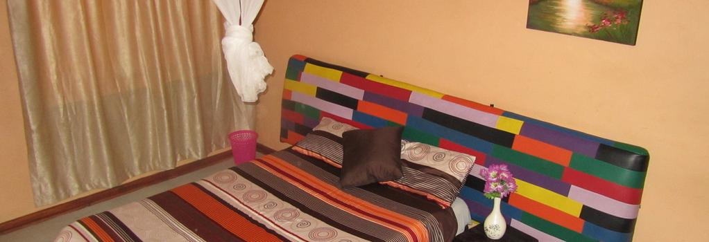 Flintstones Backpackers - Lusaka - Bedroom