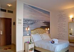 Hotel Sovrana - ริมินี - ห้องนอน