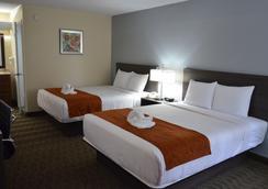 Days Inn & Suites Orlando Airport - ออร์แลนโด - ห้องนอน