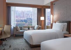 New World Shanghai Hotel - เซี่ยงไฮ้ - ห้องนอน