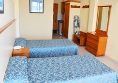 Apartamentos Tropical Garden - อิบิซา - ห้องนอน
