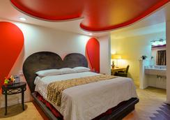 Romantic Inn & Suites - ดัลลัส - ห้องนอน