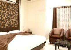 Hotel Ira Executive - ออรังคาบัด - ห้องนอน