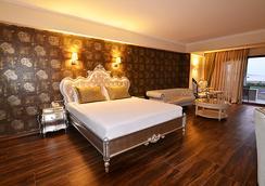Azka Hotel - โบดรัม - ห้องนอน