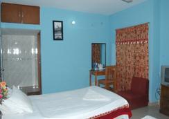 Traveller Inn - ธากา - ห้องนอน