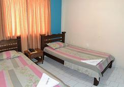 Hotel La Puerta Del Sol - บูคารามังกา - ห้องนอน