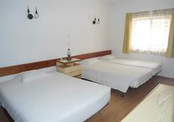 Residencial Arabi - ปอร์ติเมา - ห้องนอน