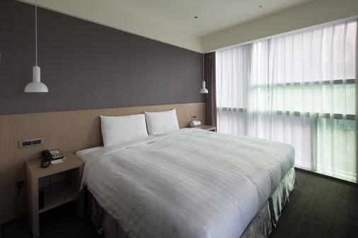 โรงแรมไฉอิน - ตงเหมิน - ไทเป - ห้องนอน