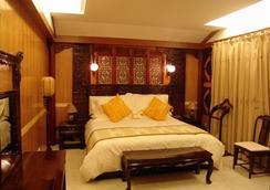 Lijiang Dian Jun Wang Hotel - ลี่เจียง ซิตี้ - ห้องนอน