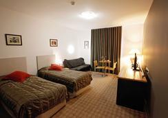 Golden Pebble Hotel - เมลเบิร์น - ห้องนอน