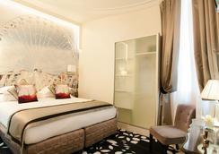 Hotel Ile de France Opéra - ปารีส - ห้องนอน