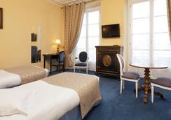 Hotel du Quai Voltaire - ปารีส - ห้องนอน