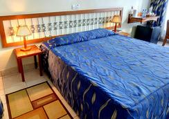 Sentrim Boulevard Hotel - ไนโรบี - ห้องนอน