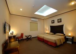 Casa Bocobo Hotel - มะนิลา - ห้องนอน