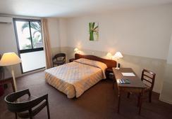Hotel Austral - แซ็ง-เดอนี - ห้องนอน