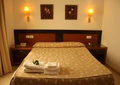Hotel Restaurante Blanco y Verde - โกนิล เด ลา ฟรอนเตรา - ห้องนอน