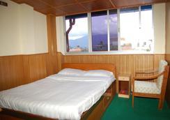Hotel Visit Nepal - กาฐมาณฑุ - ห้องนอน