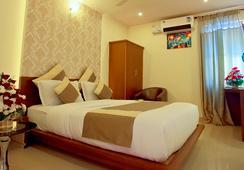 Aishwarya Suites - มัยซอร์ - ห้องนอน