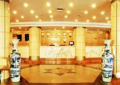 Qingdao Huaneng Hotel - ชิงเต่า - ล็อบบี้
