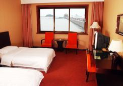 Qingdao Huaneng Hotel - ชิงเต่า - ห้องนอน