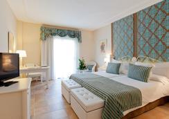 Lago Garden Apart-Suites & Spa Hotel - กาลา รัตจาดา - ห้องนอน