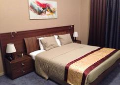 Home to Home Hotel Apartments - Deluxe - ดูไบ - ห้องนอน