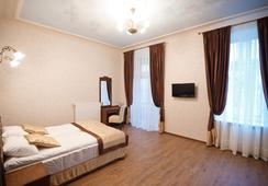 Guest House Inn Lviv - ลวิฟ - ห้องนอน