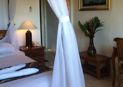 Bisma Sari Resort Ubud - อูบุด - ห้องนอน